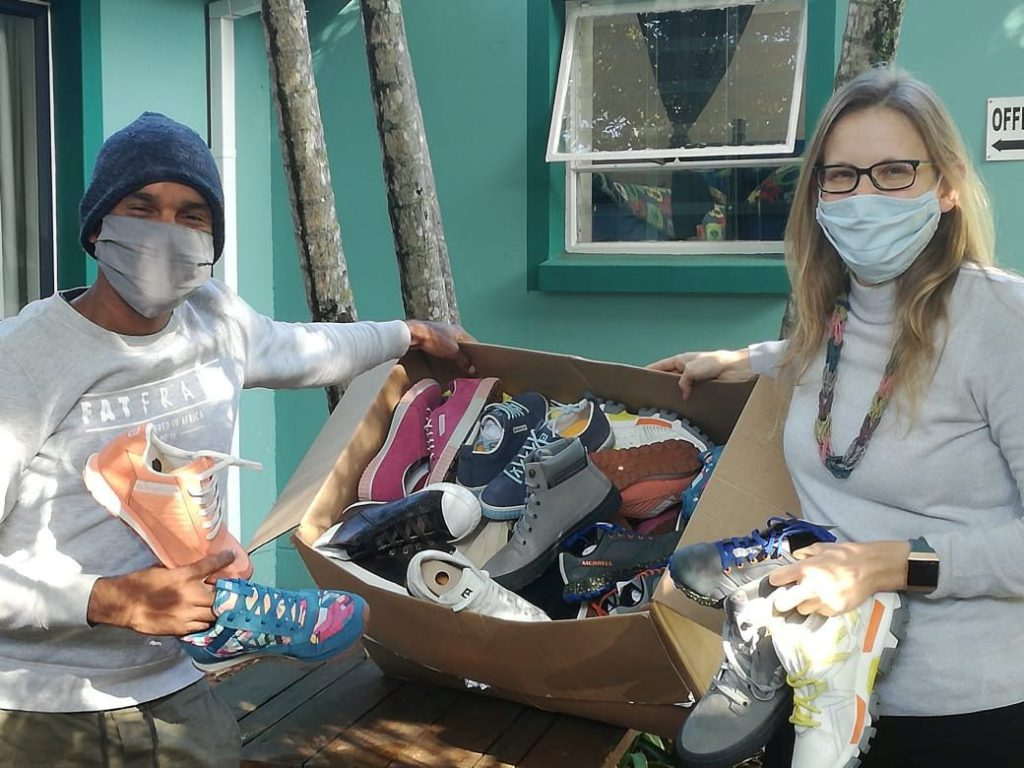 Donating shoes with face masks