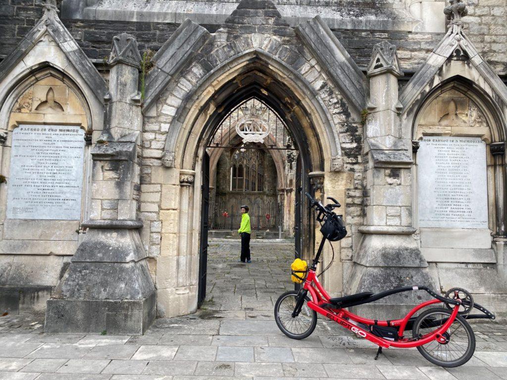 Woman in cathedral with ElliptiGO bike