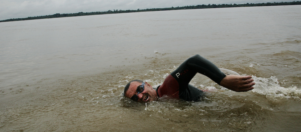 Martin Strel, the world long distance swimming record holder, 53, is swimming in the Amazon river during the rainy forest storm. This is the 41st day since he started to swim in the river to break his own world record, and he swims 70 k/m to 80 k/m per day for the average. Mar 13 2007, Amazon, Brazil.