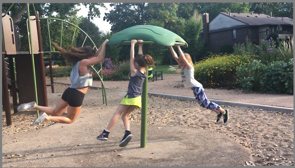 Jennifer playing with her two girls at their local playground