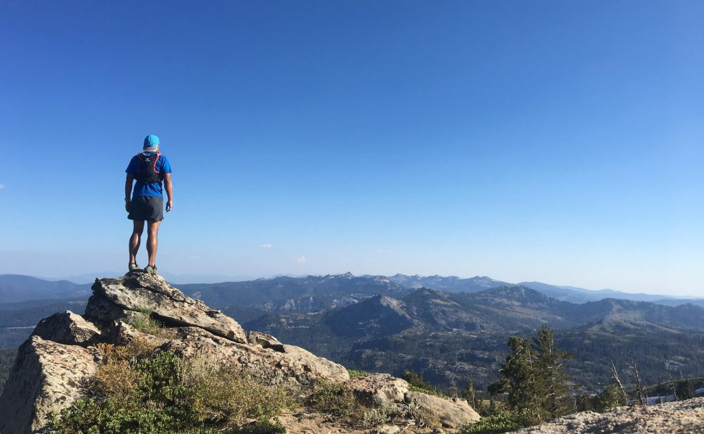 Joey Tajan, Merrell Ambassador, taking in the view on a training run