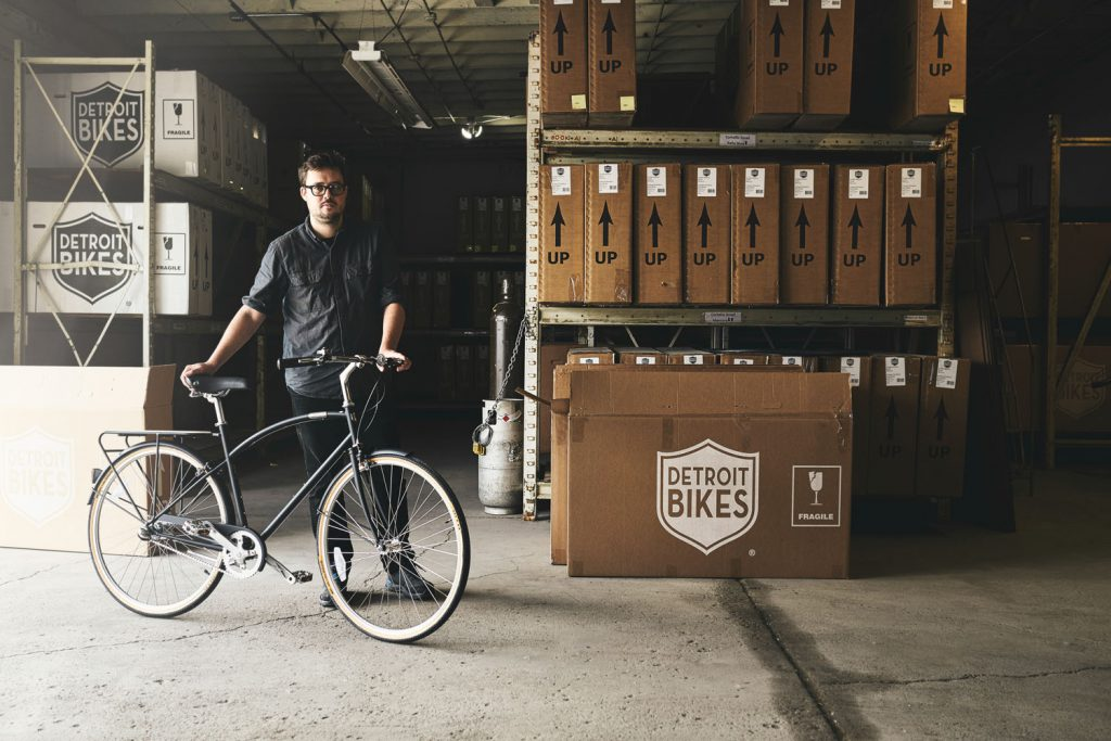 man with bike in warehouse