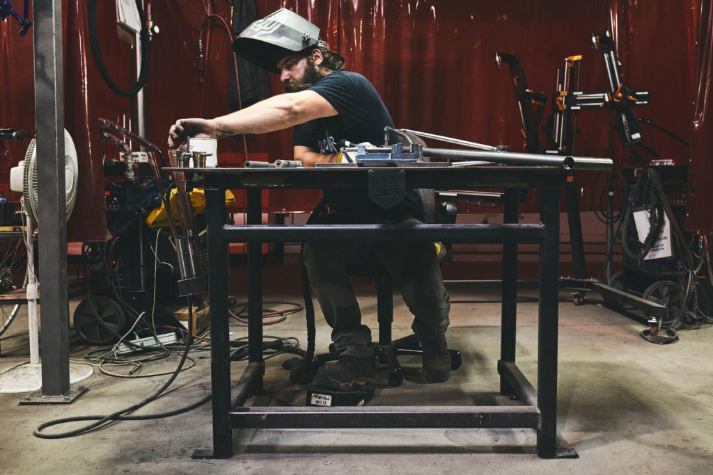 man welding bike