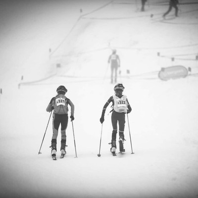 two sisters skiing on a snowy mountain