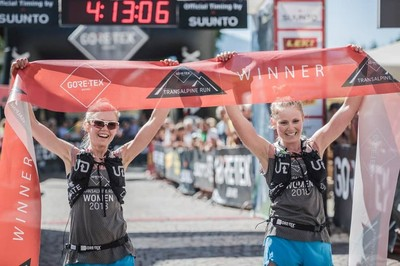 two sisters finishing a race together