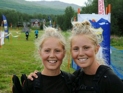 two sisters posing for a picture after a race