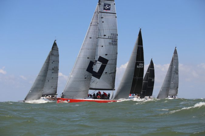 Tony Langley's big red TP52 Gladiator leads ORC Class A offshore. © Meredith Block.