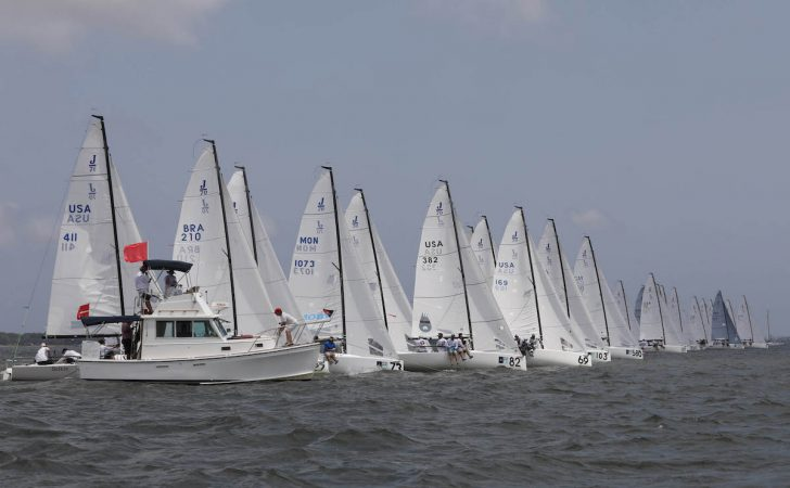The ever-aggressive J/70 Class gets off the staring line. © Tim Wilkes.