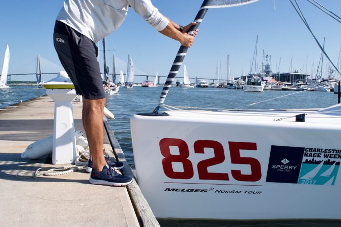The War Canoe crew pushes off from the dock wearing the America's Cup edition Sperry 7 SEAS performance boat shoe.