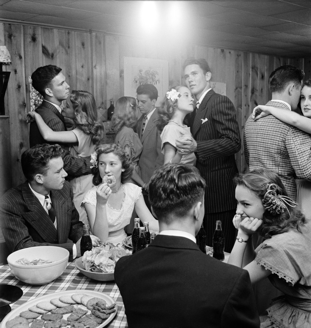 Teenagers dancing and socializing at a party.