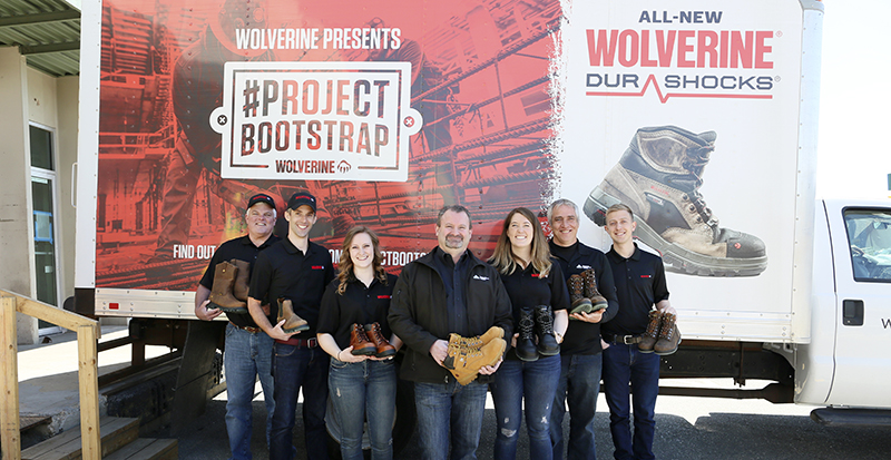 Wolverine and Colorado Homebuilding Academy team members at the Project Bootstrap event celebrate the skilled trades on Wednesday, April 18, 2018 in Denver. (Left to right) Brent Elder, Josh Cox, Melanie Dohrmann, Michael Smith, Devon Vanoostveen, Mark Babcock and Michael Boss. (Barry Gutierrez/AP Images for Wolverine)